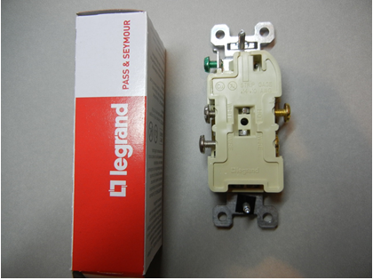 Rear view of recalled receptacle with packaging with arrow pointing to location of date code
