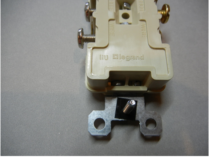 Rear view of recalled receptacle with location of date code circled