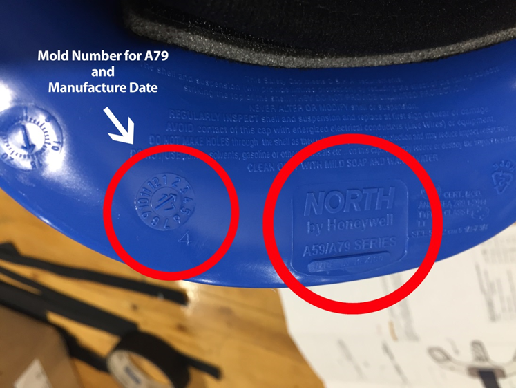 North by Honeywell, the mold identification number, and the manufacture date can be found on the underside of the hat's brim.