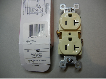 Front view of recalled receptacle with packaging and model number circled in red