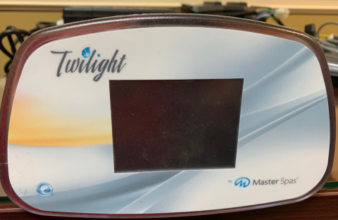 """A Master Spas control panel cover showing the brand name """"Twilight"""""""
