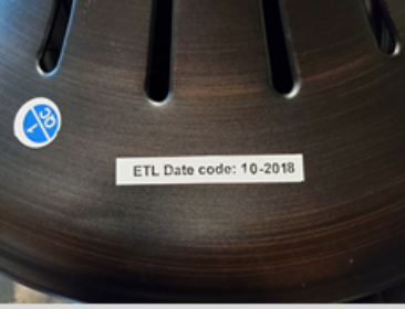 The manufacture date in MM-YYYY format can be found on a label on top of the motor housing.